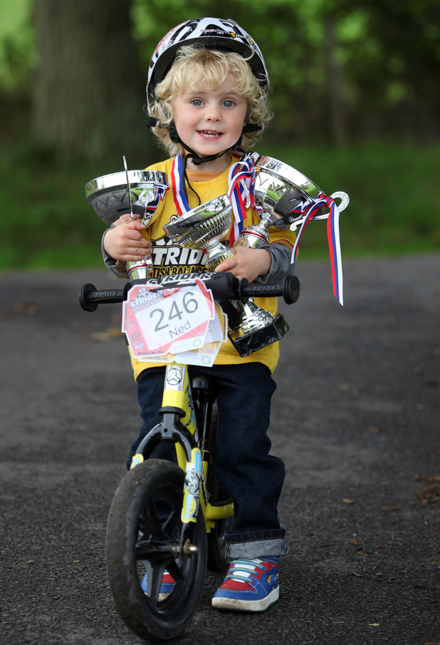 Two-year-old boy is Britain's youngest BMX champion, Selescombe, East Sussex, Britain - 03 Oct 2013 2-year-old Ned Jones with his bike and some of his recent trophies 3 Oct 2013