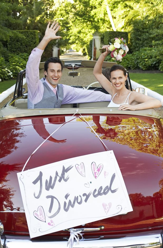 Happy couple in a convertible car waving with just divorced sign on it Model Released - Happy couple in a convertible car waving with just divorced sign on it 2011