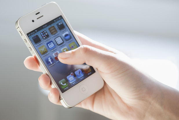 Model Released - Young woman using iphone, close up 2012