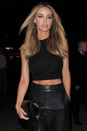 Lauren Pope and Chloe Sims on a night out at STK London restaurant. Chloe wore a black waistcoat and a 'Coco Made Me Do It' t-shirt, 24 October 2013