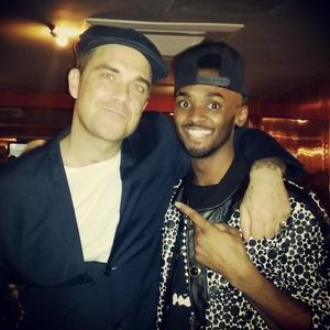 Robbie Williams with X Factor contestant Joey from Rough Copy during Olly Murs' Football Night Out