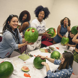 Girls carving watermelons for Halloween - October 2013