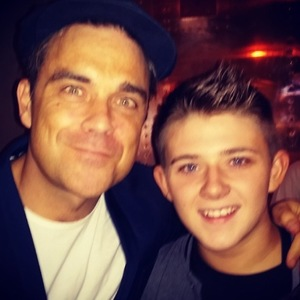 Robbie Williams with X Factor contestant Nicholas McDonald during Olly Murs' Football Night Out