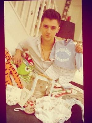 Union J star JJ Hamblett shows off baby presents from fans.