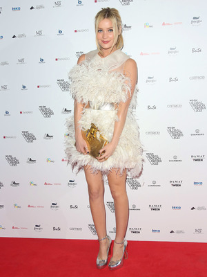 Laura Whitmore poses on the red carpet at the WGSN Fashion Awards at the V&A museum - London 30th October 2013