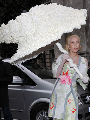 Lady Gaga leaves her hotel on Halloween wearing a Japanese inspired outfit and a huge seashell umbrella
