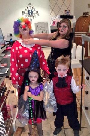 Kerry Katona dresses as a clown for Halloween and poses alongside children Molly, Max and Heidi  (31 October 2013).