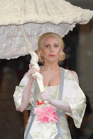 Lady Gaga seen leaving her hotel in London under a shell umbrella - 10/31/2013