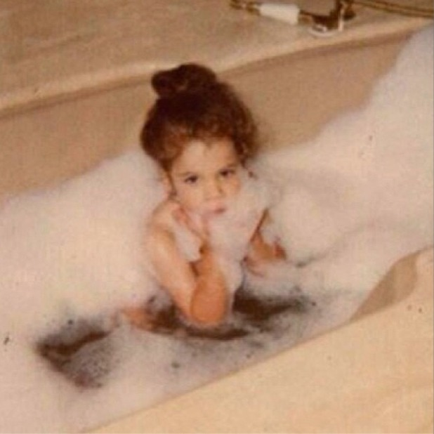 Khloe Kardashian shares picture of herself as a toddler in the bath on 'Flashback Friday', November 1 2013