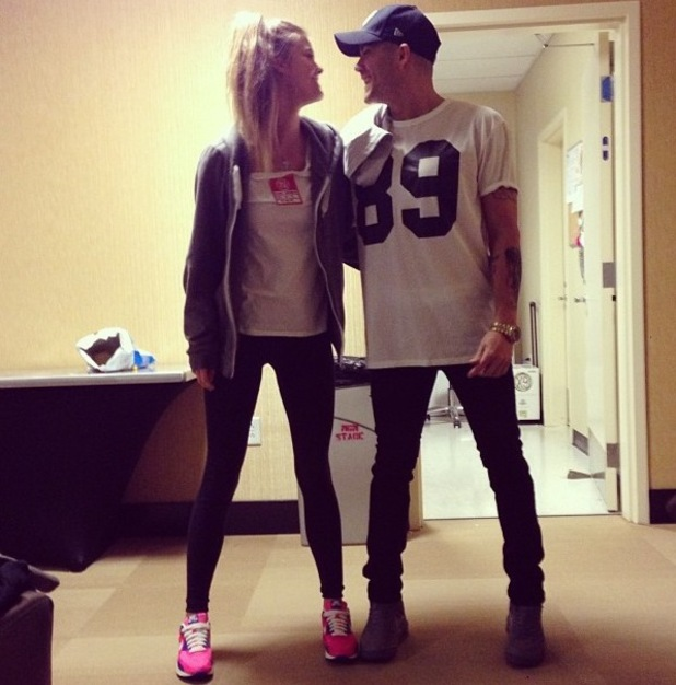 Nina Agdal and boyfriend The Wanted's Max George play games during tour (26 October)