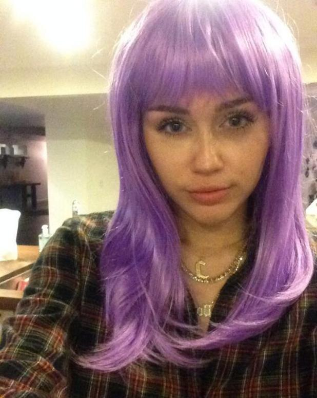 Miley Cyrus tries on purple wig - 30 October 2013