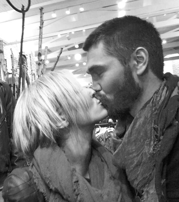 Chad Michael Murray kisses girlfriend Nicky Whelan in a Twitter photo dated 30 October 2013