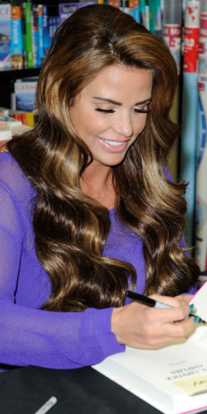 """Katie Price signs copies of her new autobiography, """"Love, Lipstick and Lies"""" at WH Smith, Luton, Bedfordshire, 27 October 2013"""