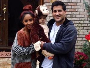 Snooki poses with Jionni and Lorenzo at Halloween, November 2013