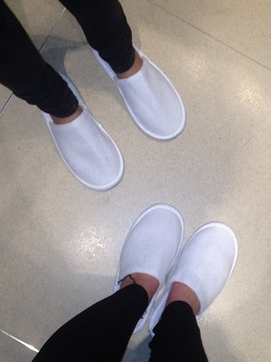 Helen Flanagan and a mate wear slippers at a hotel, Nov 13