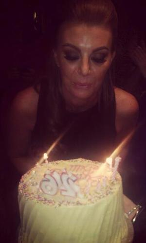 Billi Mucklow celebrates her 26th birthday and blows out the candles on her cake.