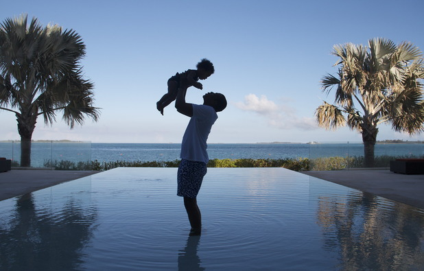 Jay-Z holds daughter Blue Ivy in the air in photo posted by Beyonce. (4 November).