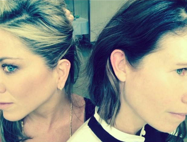 Jennifer Aniston gets the top of her ear pierced with make-up artist friend Gucci Westman