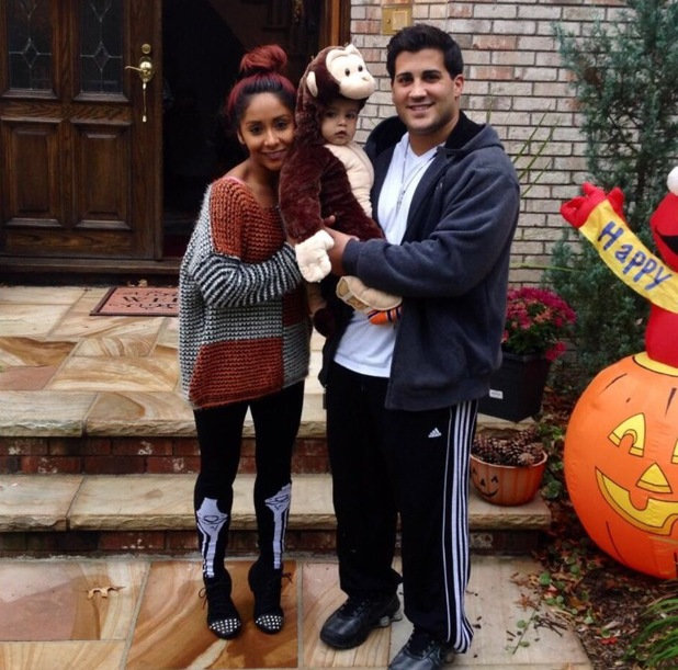 Snooki poses with Jionni and Lorenzo at Halloween, November 2013