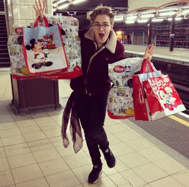Tom Fletcher holds Disney Store shopping bags in London - 6.11.2013
