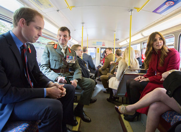 Prince William and Catherine Duchess of Cambridge riding on a red London Bus for London Poppy Day, 7 Nov 2013