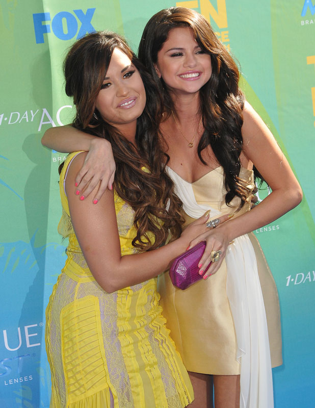 Demi Lovato and Selena Gomez, 2011 Teen Choice Awards held at Gibson Amphitheatre - Arrivals Universal City, California - 07.08.11