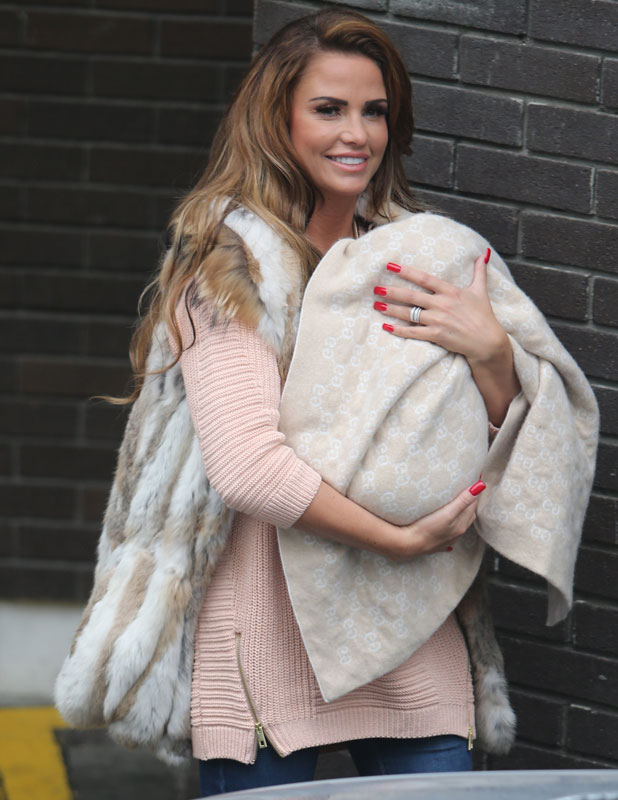 Katie Price keeps baby Jett shielded from the cameras outside the ITV studios, London, 6 November 2013