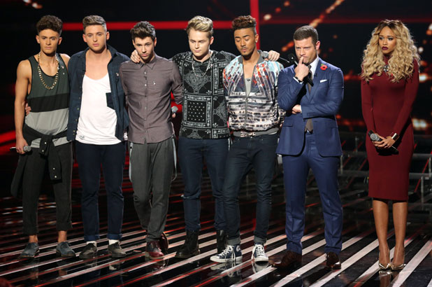 Dermot O'Leary with Kingsland Road and Tamera Foster after they land in the X Factor bottom two in Disco Week, 3 November 2013
