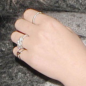 Perrie Edwards flashes engagement ring as 'Little Mix' arrive at Whisky Mist nightclub following their performance on the X Factor, 3 November 2013