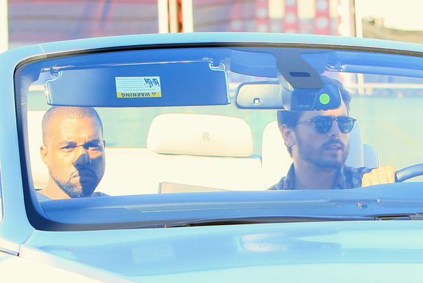 Kanye West and Scott Disick seen leaving Maxfields clothing store wearing the same colour t-shirt. - 13.11.2013