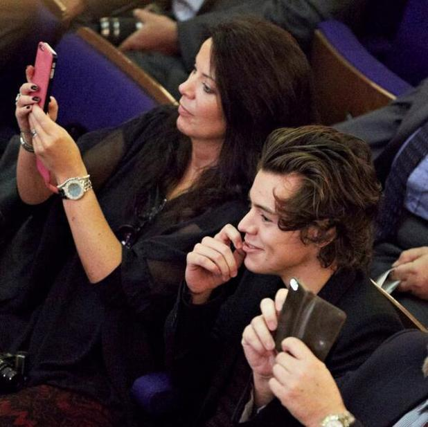 Harry Styles attends his sister's graduation at Sheffield Hallam University with his mum. (13 November)