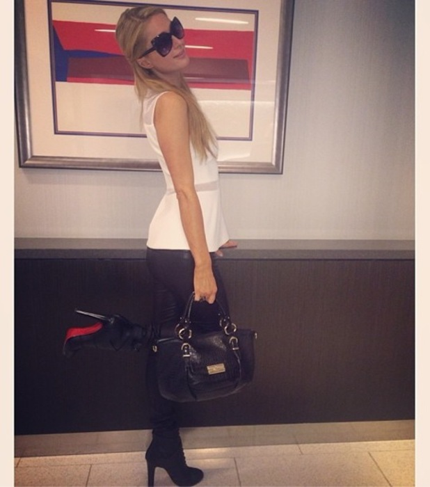 Paris Hilton takes an Instagram picture at LAX Airport in Los Angeles - 14 November 2013