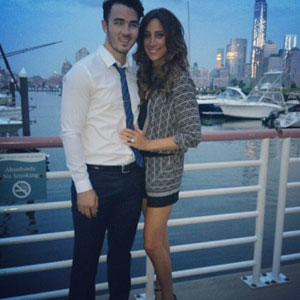Danielle and Kevin Jonas pose for a picture on his birthday, November 2013