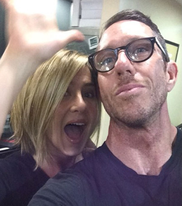 Jennifer Aniston and her hairstylist Chris McMillan pose for a selfie that shows off Jennifer's new bob haircut, November 2013