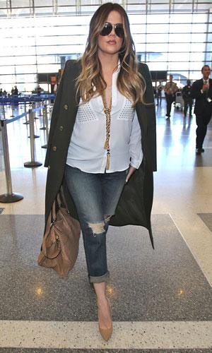 Khloe Kardashian arrives at LAX to catch a flight to London, 13 November 2013