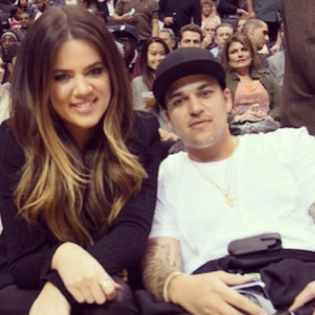 Khloe Kardashian and brother Rob at a basketball game, tweeted by Khloe on 12 November 2013