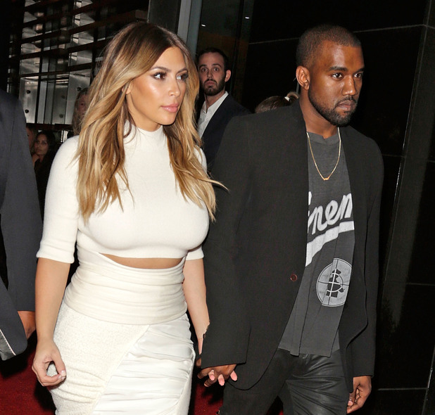 Kim Kardashian and Kanye West attend Gelila & Wolfgang Puck's Dream for Future Africa Foundation honoring Vogue Italia Editor-In-Chief Franca Sozzani at Spago Beverly Hills. 10/25/2013