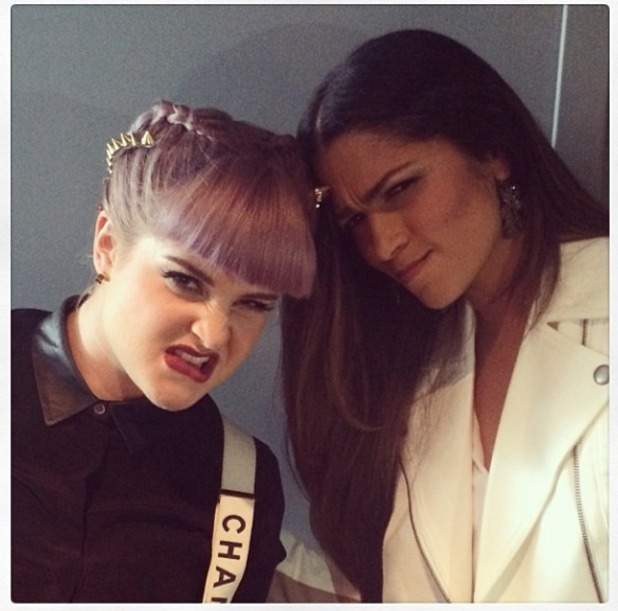 Kelly Osbourne poses with Camilla Alves, showing off her spiky hair undo on E! Fashion Police, 21 November 2013