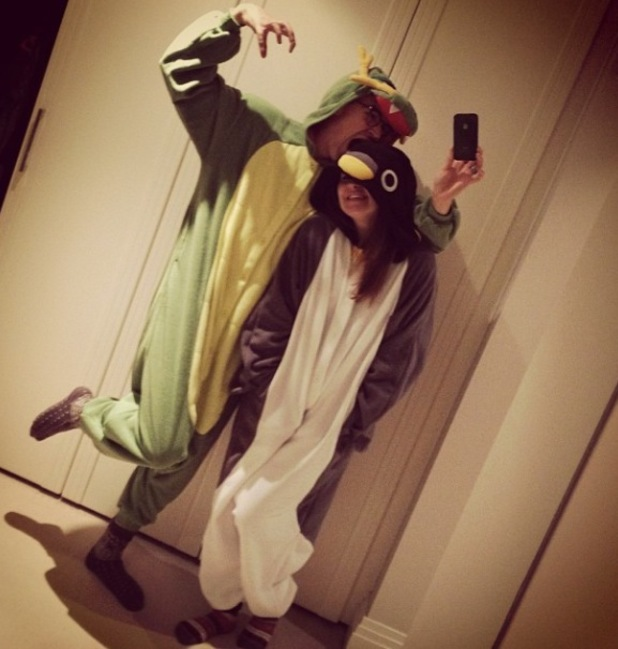Tom Fletcher and pregnant wife Giovanna Falcone pose in animal onesies - 19.11.2013