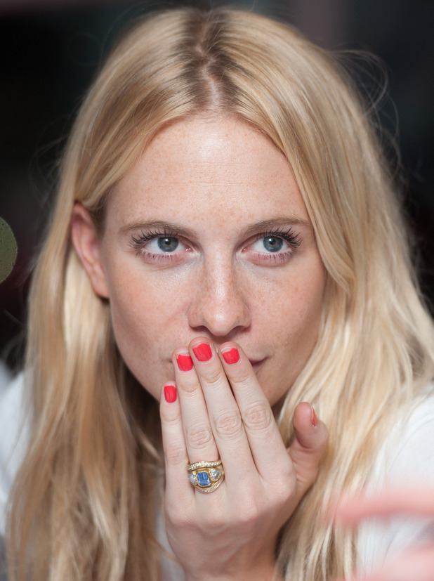 Poppy Delevingne shows off her engagement ring at a Philippines Typhoon Appeal at BT, Nov 13.