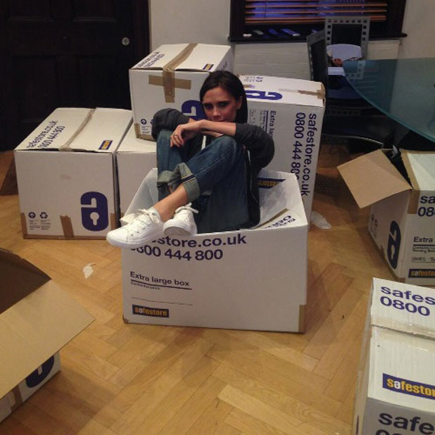 Victoria Beckham poses in a box to promote British Red Cross' Typhoon Appeal, 21 November 2013
