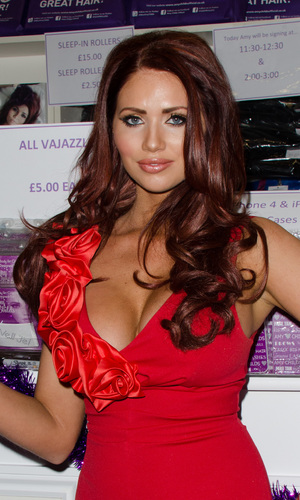 Amy Childs poses during a photocall at The Ideal Home Show at Christmas held at Earls Court, 13 November 2013
