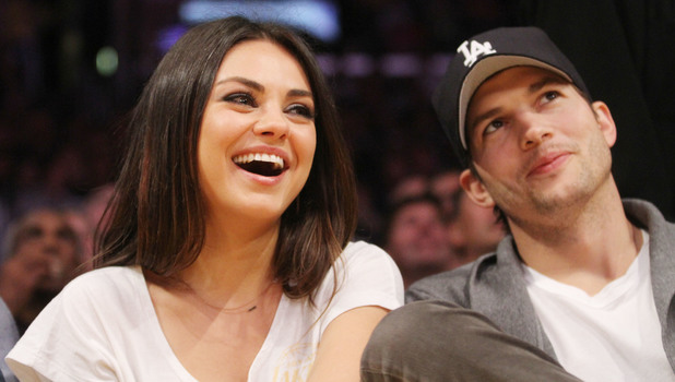 Mila Kunis and Ashton Kutcher watch the LA Lakers vs. Phoenix Suns at the Staples Center in LA - 02/12/2013