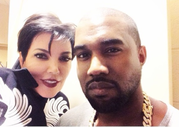 Kris Jenner poses for a photo with Kanye West backstage at his Yeezus concert in New York. 24 November 2013.