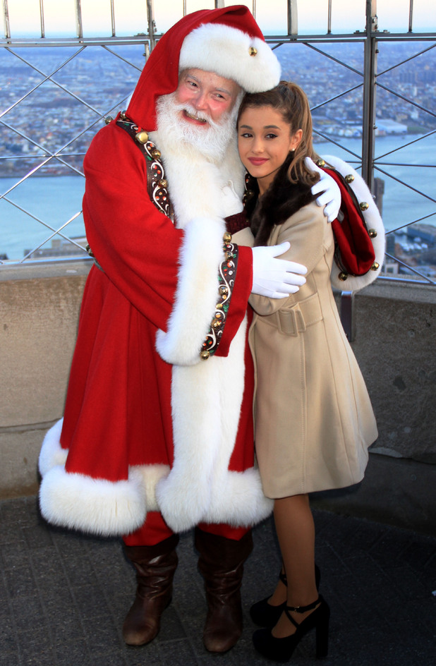 Ariana Grande and Santa Claus light up the Empire State Building. The teen star lit up the Empire State Building in fall colors to celebrate this years Thanksgiving Day. 25 November 2013