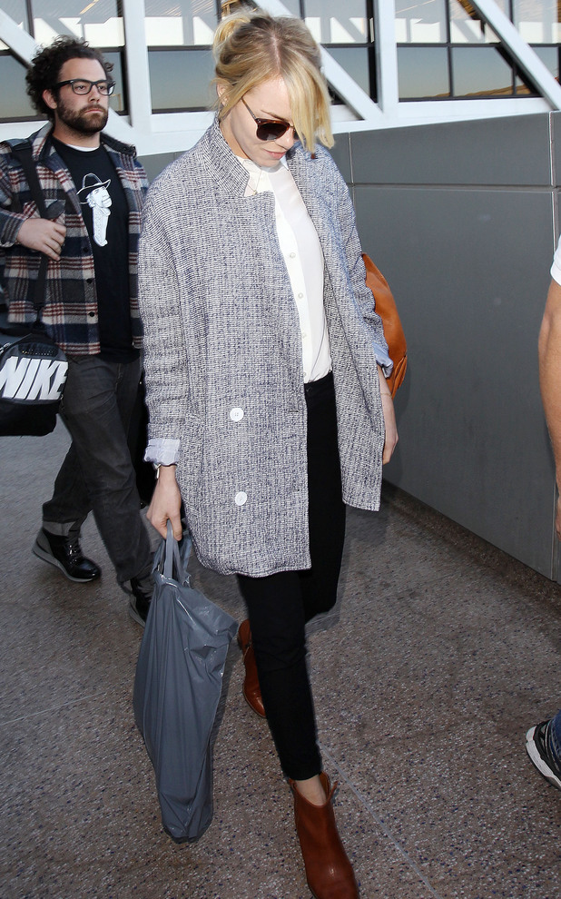 Emma Stone arrives at LAX airport in Los Angeles - 27 November 2013