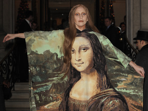 Lady Gaga announces ARTPOP Ball tour, wears giant Mona Lisa portrait!
