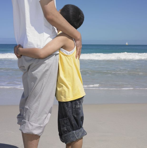 VARIOUS Model Released - Father Hugging Son On The Beach, Perth, Australia 25 Sep 2005