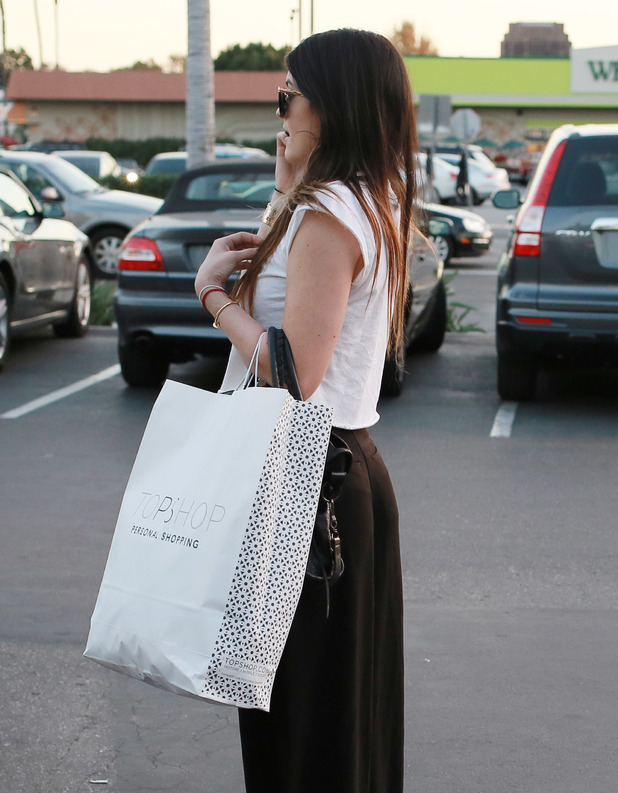 Kylie and Kendall Jenner shopping for bargains at the Top Shop inside The Grove shopping Mall - 4.12.2013