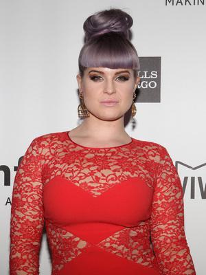 Kelly Osbourne at the 2013 amfAR Inspiration Gala 12/12/2013. Los Angeles, United States